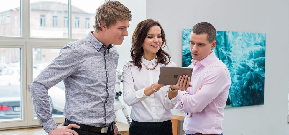 Office workers looking at tablet