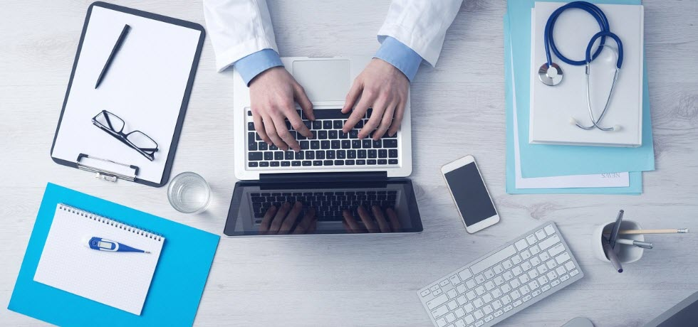 Doctor using PC for medical practice marketing