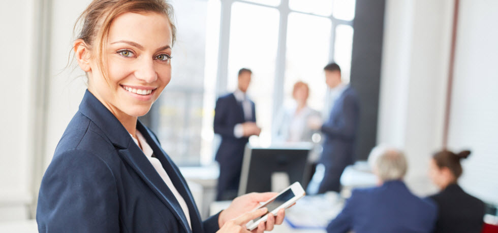 young woman with mobile phone in a meeting