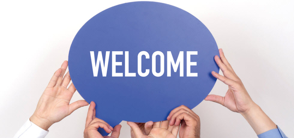 Welcome message in peoples hand