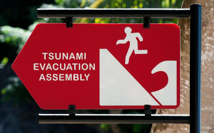 Tsunami evacuation assembly sign