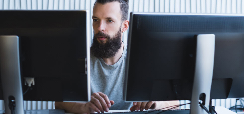 the small business owner behind 2 monitors