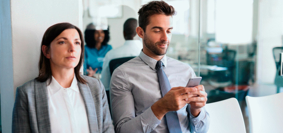 job-applicants-waiting-for-interview-while-sitting-young-man-texting