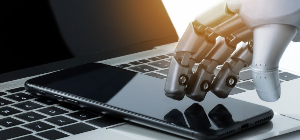 Chatbot hand with mobile phone and lap top