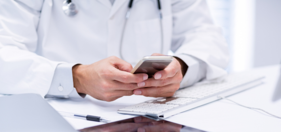 A doctor reading text message