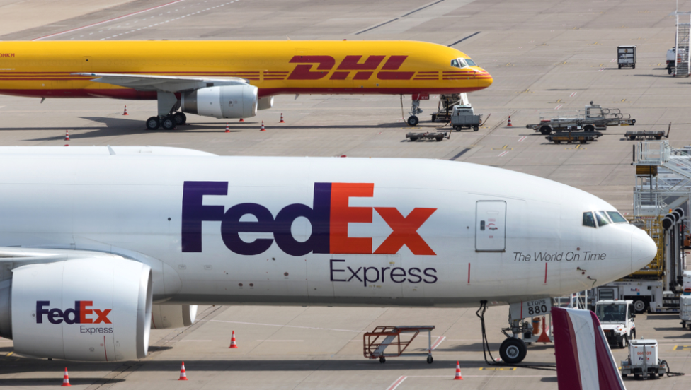 FedEx and DHL cargo planes at airfield