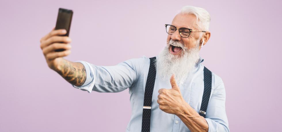 Senior happy man making selfie with smartphone