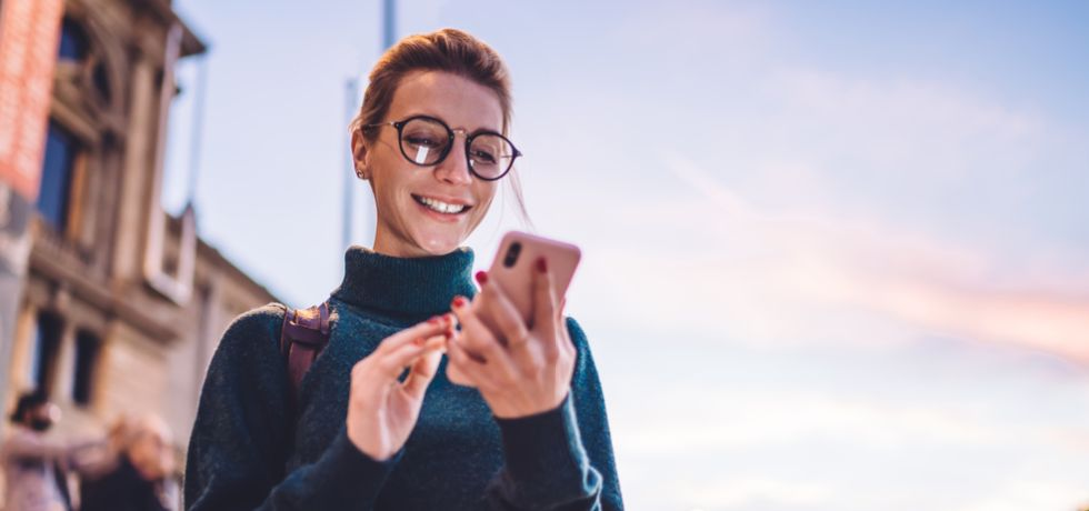 young hipster woman reading text message