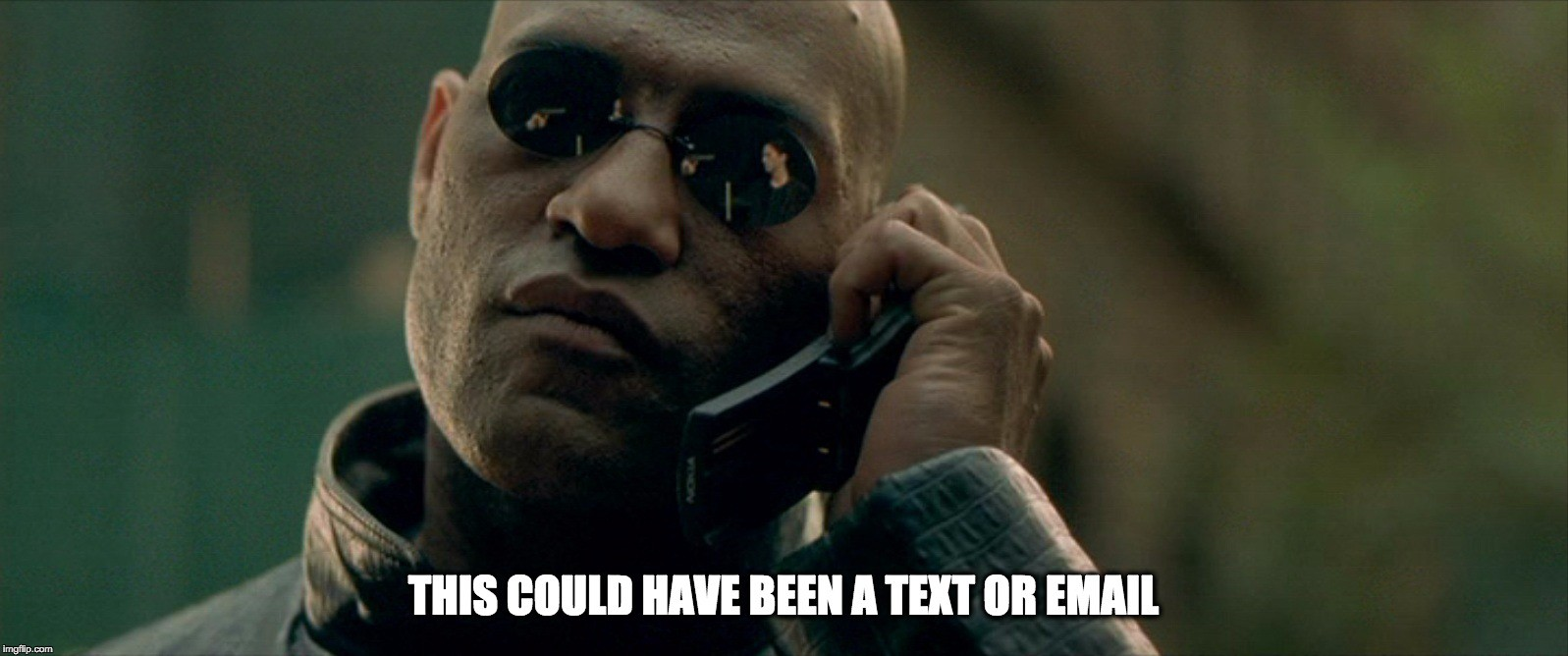 Morpheus from the Matrix movie saying to a mobile phone: this could have been a text or email
